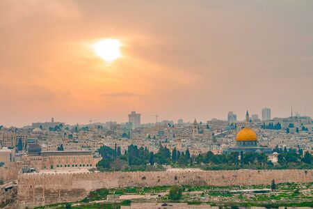Panoramic view of Jerusalem old city and the Temple Mount during a dramatic colorful sunset. A view of the Dome of the Rock and Al Aqsa Mosque from the Mount of Olives in Jerusalem, Israel.