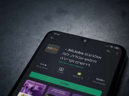 Lod, Israel - July 8, 2020: AllJobs app play store page on the display of a black mobile smartphone on dark marble stone background. Top view flat lay with copy space. Editoriali