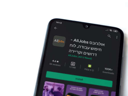 Lod, Israel - July 8, 2020: AllJobs app play store page on the display of a black mobile smartphone isolated on white background. Top view flat lay with copy space.