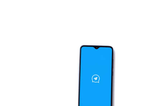 Lod, Israel - July 8, 2020: Quick Message app launch screen with logo on the display of a black mobile smartphone isolated on white background. Top view flat lay with copy space. Editöryel