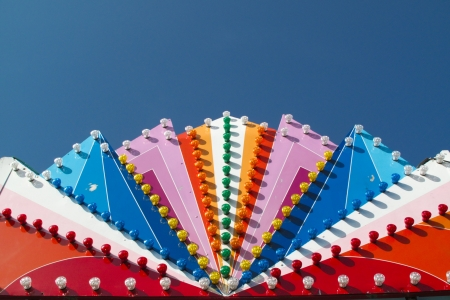 fun fair: Colorful lights of a fun fair on deep blue sky Stock Photo