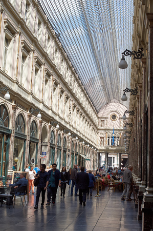 glasswork: Brussels, Belgium - July 31, 2015: Queens gallery in Brussels, people shopping or enjoying a drink. Editorial