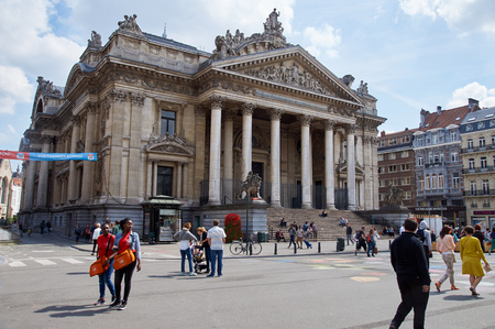 benelux: Brussels, Belgium - July 31, 2015: Brussels Stock exchange with people walking in middle of the streets. The center of Brussels is now totally car free.