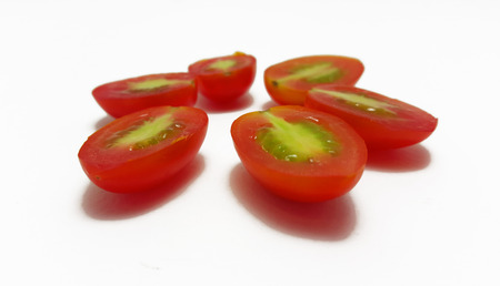 cut up: Grape tomatoes cut up in white Background
