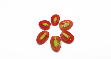 cut up: Grape tomatoes cut up in white background Stock Photo