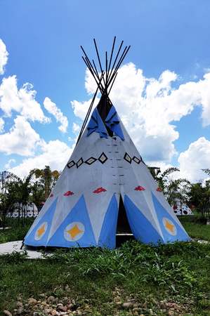teepee: Sunny day with Indian Tent on grass field Wignam, Teepee
