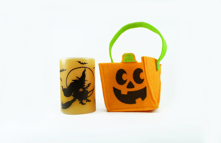 tote: Halloween orange tote and candle on white background Stock Photo