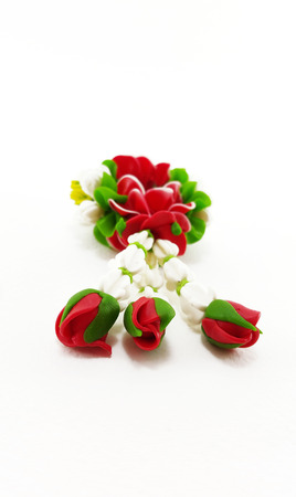 polymer: Small Polymer Clay Garland Of Jasmine Flowers on white background; Selective focus