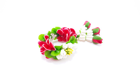 polymer: Small Polymer Clay Garland Of Flowers on white background; Selective focus Stock Photo
