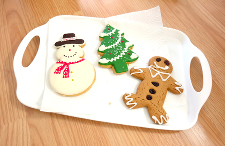 ginger bread man: Christmas tree, Snow man, Ginger bread, cookie on white tray Stock Photo