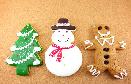 ginger bread man: Christmas cookies; snow man, Christmas tree and ginger bread man on wodden background