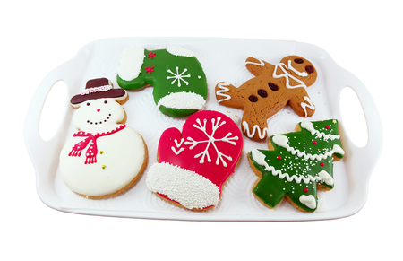 ginger bread man: Christmas cookies; snow man, Christmas tree, ginger bread man in white tray
