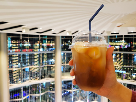 Oolong lychee iced tea with colorful bokeh background