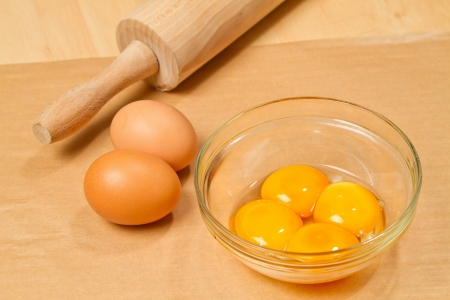 extracting: Extracting yolks Stock Photo