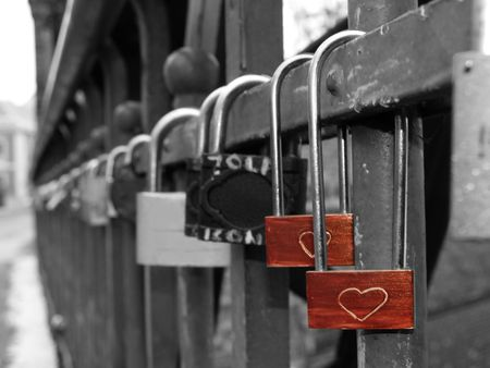 Two hearts connected for eternity. Two padlocks with hearts on them.