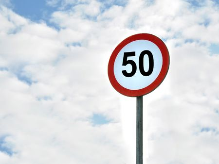 sky is the limit: 50kmh speed limit sign isolated on the sky