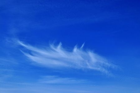 feathery: Feathery cloud in the blue sky.