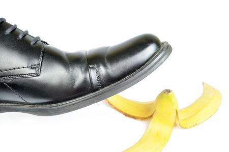 banana skin: Foot, shoe about to slip on banana peel and have an accident
