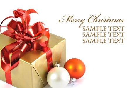 colden: Christmass gift and baubles isolated on white background Stock Photo