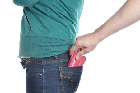 Man pulls wallet out of a woman back pocket. Stock Photo - 8089012