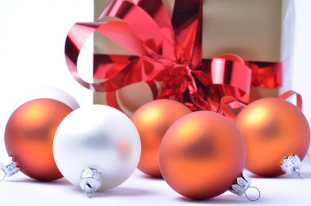 Christmas baubles and gift isolated on white background Stock Photo - 8173493