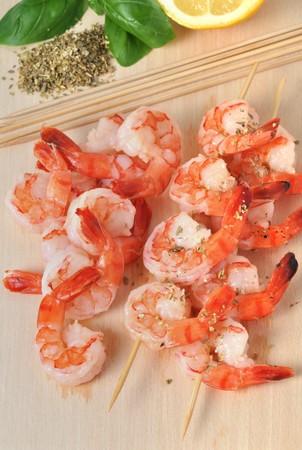 Shrimps,  lemon and basil on board isolated on white background photo