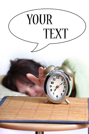 A woman is sleeping with an alarm clock in front and space for your text.