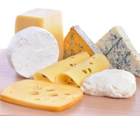 Various types of cheeses isolated on a white background. photo