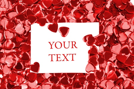 Card with space for your text on a red hearts confetti background  스톡 사진