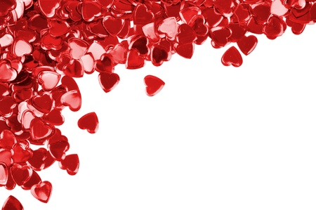 Red hearts confetti isolated on white background photo