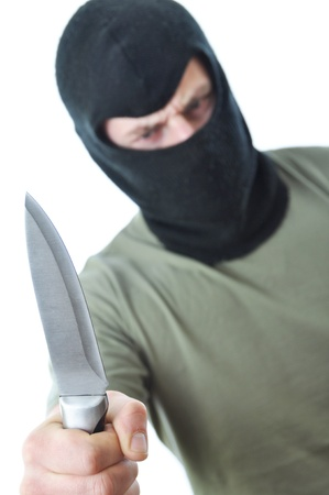 attacker: Bandit in black balaclava with knife in hand isolated on white background Stock Photo