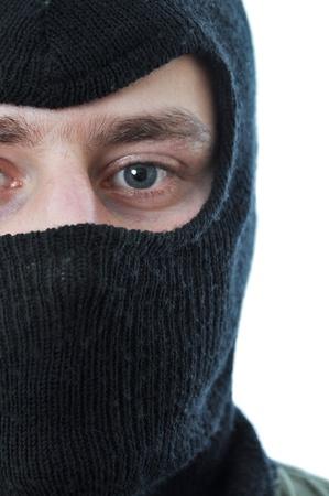 Man in black mask isolated on white background Stock Photo - 9030133