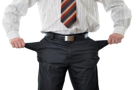economie: Zakenman met lege zakken geïsoleerd op witte achtergrond