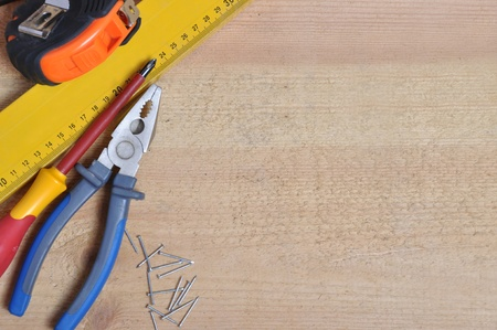 Complete of tools on a wooden background photo