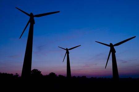 Silhouette of wind power station on sunset Stock Photo - 10800034