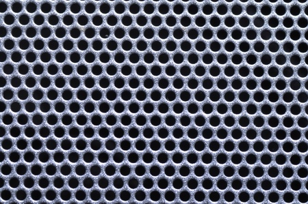 Shiny silver metal pattern with reflective round holes Stock Photo - 11376516
