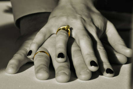 wedding rings on fingers in sepia Stock Photo - 12674480
