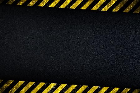 Grainy dark background with yellow caution stripes Zdjęcie Seryjne - 13323922