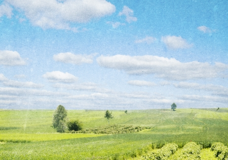 Rural landscape with green hill and blue sky in watercolor photo