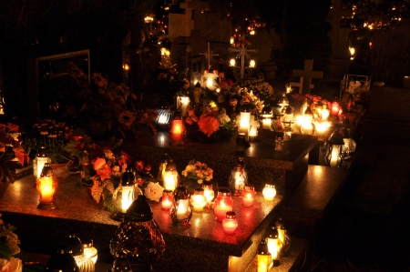Candle flames illuminating on Polish cemetery during All Saints Day photo