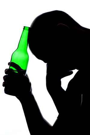 Silhouette of man drinking alcohol isolated on white background Stock Photo - 16521000