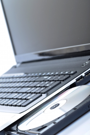 burner: Laptop with open CD - DVD drive  Stock Photo