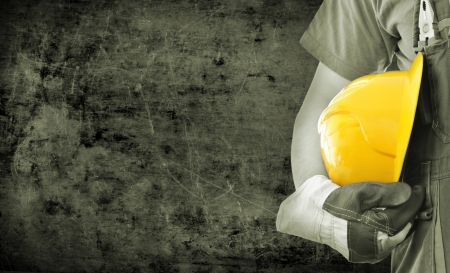 Worker and grunge texture in background  Concept of OSH  occupational safety and health  Stock Photo