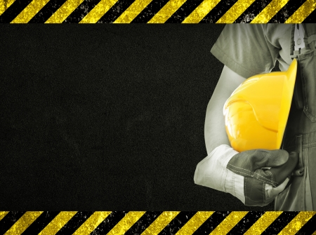 safety wear: Worker and dark texture in background  Concept of OSH  occupational safety and health
