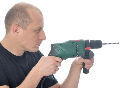 Handyman with drill over white background photo