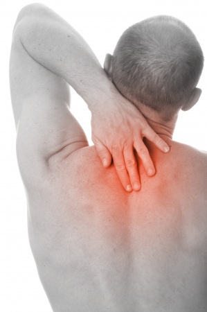 Man with neck pain over white background  Stock Photo - 18443842