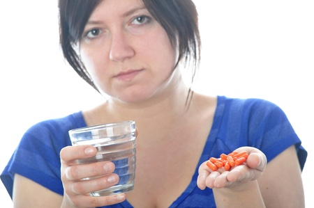Woman with pills over white background Stock Photo - 18443836