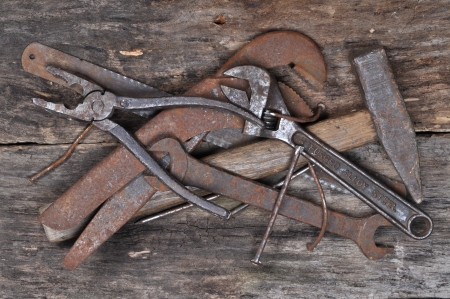Complete of old tools on a wooden background  Stock Photo - 19583389