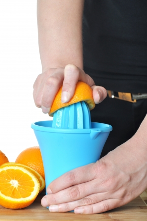 Preparing 100  orange juice using squeezer  photo