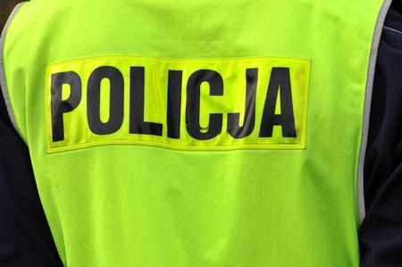 security vest: Back of polish policeman and inscription policja
